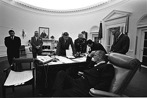 1967 Detroit riot - July 24, 1967. President Lyndon B. Johnson (seated, foreground) confers with (background L-R): Marvin Watson, FBI Director J. Edgar Hoover, Sec. Robert McNamara, Gen. Harold Keith Johnson, Joe Califano, Sec. of the Army Stanley Rogers Resor, on responding to the riots