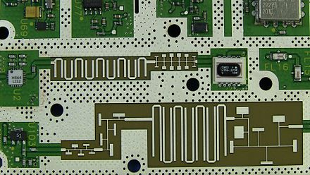 The PCB inside a 20GHz Agilent N9344C spectrum analyser showing various microstrip distributed element filter technology elements Microstrip Distributed Element Filter Technology.jpg