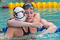 Missy Franklin embraces Kendyl Stewart after 200m backstroke (8991936765).jpg