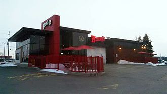 Wendy's - A Wendy's restaurant in Kingston, Ontario, built just before the introduction of the new logo in 2012.
