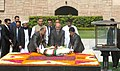 Mohammad Ashraf Ghani laying wreath at the Samadhi of Mahatma Gandhi, at Rajghat, in Delhi on April 28, 2015. The Minister of State for Finance, Shri Jayant Sinha is also seen.jpg