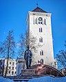 Monument to Jānis Čakste and Jelgava Holy Trinity Church Tower in Jelgava.jpg