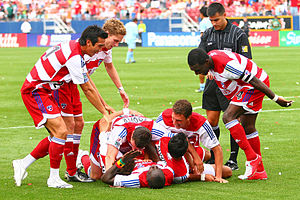 FC Dallas players congratulate Dominic Oduro after scoring the winning goal against the Colorado Rapids in 2007
