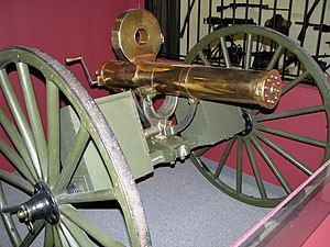 Magazine (firearms) - Gatling gun with Accles drum, an odd loading device resembling a pan magazine in that the rotary follower was operated by the gun's action rather than a spring