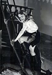 Climbing a ladder wearing a pirate's outfit