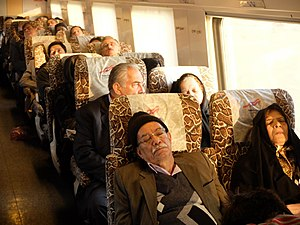 Islamic Republic of Iran Railways - Passengers on board a train from Yazd to Tehran watch movies and sleep, 2014