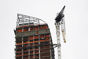 One57 - Dangling construction crane at the top of the building on the day after Hurricane Sandy