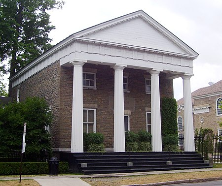 The Clark Estates building, originally the Otsego County Bank, was built in 1831 in the Greek Revival style Otsego County Bank Building 19 Main Street Cooperstown.jpg