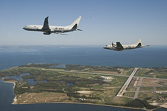 Maritime patrol aircraft - A Boeing P-8 Poseidon and a Lockheed P-3 Orion over Naval Air Station Patuxent River