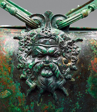 Pan (god) - Mask of the god Pan, detail from a bronze stamnoid situla, 340–320 BCE, part of the Vassil Bojkov Collection, Sofia, Bulgaria