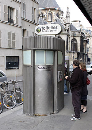 Pay toilet - A freestanding, coin-operated pay toilet stall in Paris.