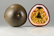 Photographs of a passionfruit in cross section and entire. The inner flesh is yellow and the exterior of the fruit is purple.