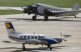 Lufthansa Flight Training - A flight training Piper Cheyenne in front of a historic Junkers 52