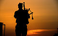 Piper with 4 SCOTS Playing as the Sun Goes Down in Afghanistan MOD 45157896.jpg