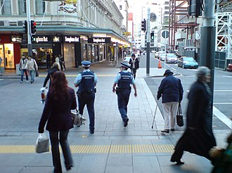 New Zealand Police - Police officers on foot in the Auckland CBD, wearing stab resistant vests over normal uniforms