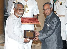 Pranab Mukherjee presenting the Sangeet Natak Akademi Fellowship to Shri Heisnam Kanhailal, at the investiture ceremony of the Sangeet Natak Akademi Fellowships and Sangeet Natak Akademi Awards-2011, at Rashtrapati Bhavan.jpg