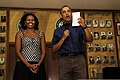 President Barack Obama, right, and first lady Michelle Obama speak to Service members during a Christmas Day visit to Marine Corps Base Hawaii Dec. 25, 2013 131225-M-DP650-003.jpg