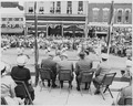 President Harry S. Truman and other dignitaries on the reviewing platform, watching a parade, in Bolivar, Missouri.... - NARA - 199906.tif