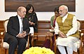 Prime Minister Narendra Modi in talks with French Defence Minister of France Jean-Yves Le Drian.jpg
