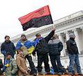 Protester with Organization of Ukrainian Nationalists (OUN) flag.jpg