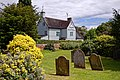 Queen's Head pub and St Andrew's churchyard, Boreham, Essex, England.jpg