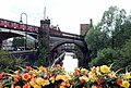 Railway bridge and flowers - panoramio.jpg