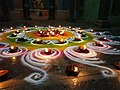 Rangoli with small lamps in a puja at a temple 2.jpg