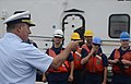 Rear Adm. Michael Parks welcomes the crewmembers of Coast Guard Cutter Morro Bay 130616-G-VH840-300.jpg