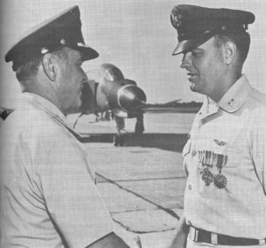Raymond J. Reeves - Presenting the Silver Star, Distinguished Flying Cross, and Air Medal to his son, Air Force Capt. Raymond J. Reeves (right).