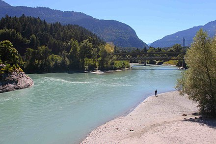 The confluence of the Anterior Rhine to the lower left and the Posterior Rhine in the back, forming the Alpine Rhine to the left next to Reichenau Rheinzusammenfluss.JPG