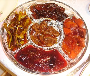 Fruit preserves - Five varieties of fruit preserves (clockwise from top): apple, quince, plum, squash, orange  (in the center)