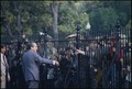 Richard M. Nixon speaking to crowds through the fence outside the White House. - NARA - 194546.tif