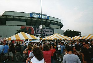 The Rising Tour - The festive park scene in the Giants Stadium parking lot for banner-celebrated, 10-night stand of The Rising Tour during July 2003.