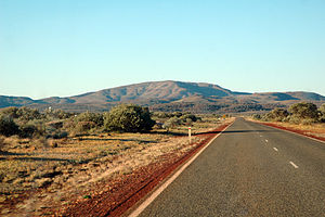 Paraburdoo, Western Australia - Highway just outside the town of Paraburdoo showing the high iron oxide concentrations in the soil