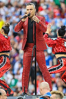 Robbie Williams British singer and entertainer