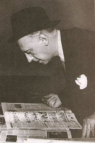 Roberto Noble - Clarín founder and director Roberto Noble scans one of his news daily's first issues in 1945.