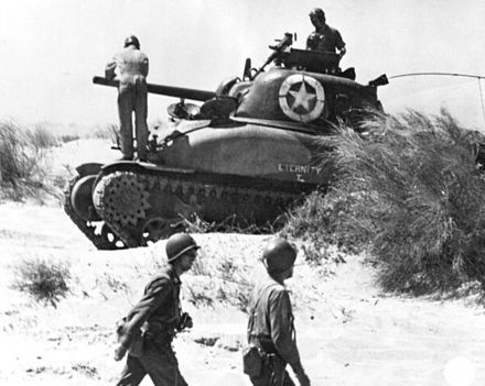 The first Sherman in U.S. service, the M4A1, appeared in the North Africa Campaign. Here one of the 7th Army lands at Red Beach 2 on July 10, 1943 during the Allied invasion of Sicily SC180455t.jpg