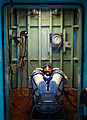 STS-135 Doug Hurley with his Sokol spacesuit in a pressure chamber.jpg