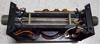 SWR meter - Interior view of an SWR meter. The three parallel coupled lines are visible. Diodes, capacitors and termination resistors are mounted at the ends of the sense lines.