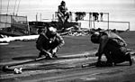 Sailors with catapult bridle on USS Hancock (CV-19) 1975.jpg