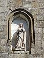 Saint-Julien-de-Lampon église statue au-dessus portail.JPG