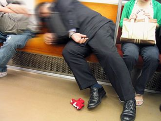 Salaryman - A salaryman asleep on the Tokyo subway.