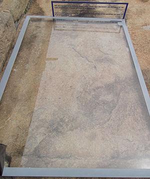 Sallekhana - An inscription (No.130) in memory of Vinayadevasena who observed Sallekhana. 7th century Kannada script. Found at Shravanbelgola, Karnataka, India.