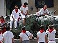 San Fermin Celebrants on Bull Sculpture - Pamplona - Navarra - Spain (14604704084).jpg