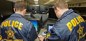 United States Secret Service - Secret Service agents conducting electronic investigations.