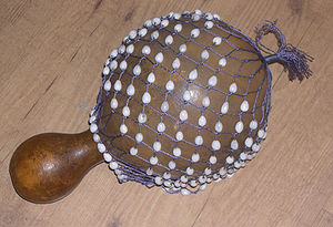 Shekere - Gourd shekere from Africa with seeds in the net