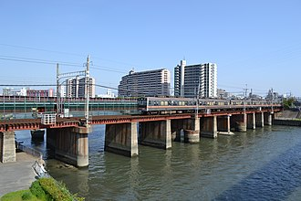 Hankyu Senri Line - Senri Line train crossing the Kanzaki River (between Shimo-Shinjō Station and Suita Station), April 2013
