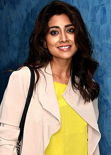 Shriya Saran is seen smiling at the camera.