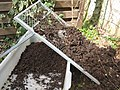 Sieving the compost with a coarse sieve (8915941421).jpg