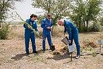 Soyuz MS-09 crew during the tree planting ceremony.jpg